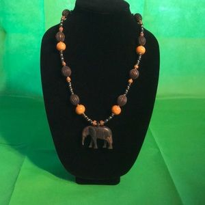 Wood-like tribal beaded elephant pendant necklace